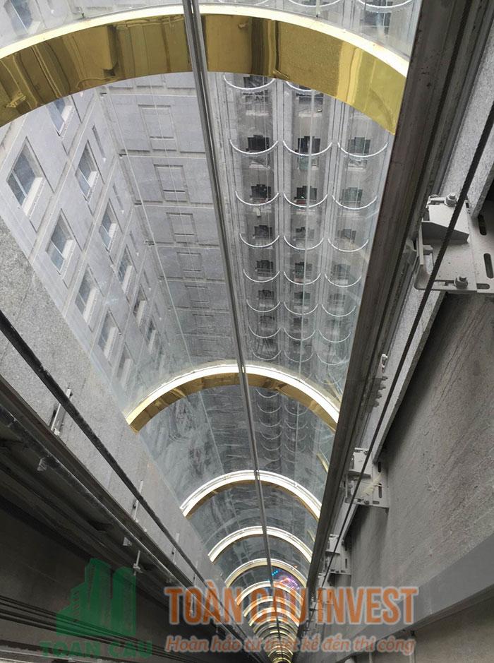 Thi công vách kính thang máy Tòa nhà D'Palais Louis – Tân Hoàng Minh